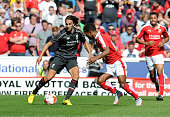 Lazar Markovic of Liverpool competes with Nathan Byrne of Swindon Town during a preseason friendly at County Ground on August 2 2015 in Swindon...