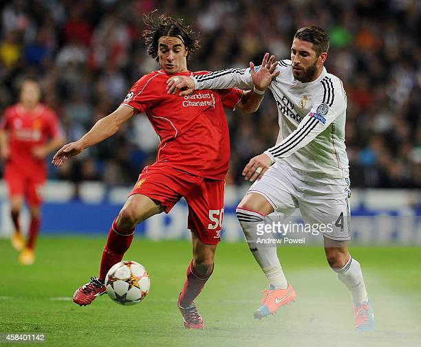 Lazar Markovic of Liverpool competes with Sergio Ramos of Real Madrid CF during the UEFA Champions League match between Real Madrid CF and Liverpool...
