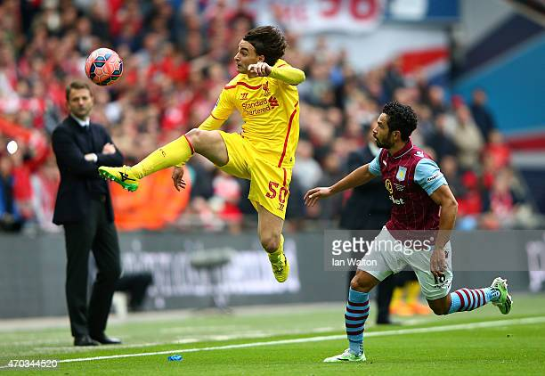 Lazar Markovic of Liverpool controls the ball under the watchful eye from Kieran Richardson of Aston Villa during the FA Cup Semi Final between Aston...