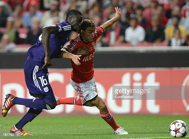 Lazar Markovic of SL Benfica is challenged by Cheikhou Kouyate of RSC Anderlecht during the UEFA Champions League group stage match between SL...