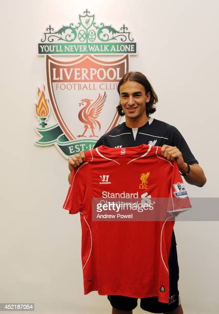 Lazar Markovic poses as he is unveiled as a new signing for Liverpool Football Club at Melwood Training Ground on July 15 2014 in Liverpool England