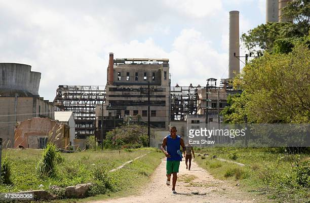 Lazaro Overtes Gomez Lugo jogs down a dirt road to the Mayabeque Boxing Academy with the old Hershey sugar factory in the background on May 12 2015...