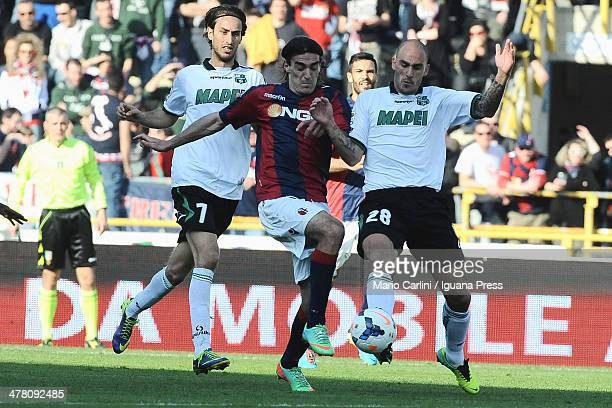 Lazaros of Bologna FC competes the ball with Paoloi Cannavaro of US Sassuolo Calcio during the Serie A match between Bologna FC and US Sassuolo...