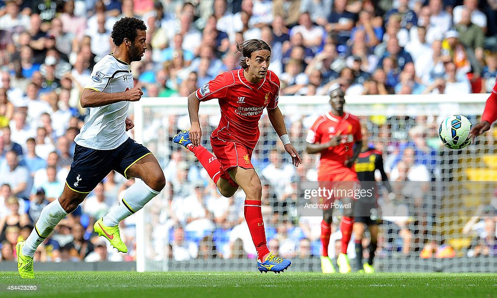 Lazer Markovic of Liverpool competes with Mousa Dembele of Tottenham Hotspur during the Barclays Premier League match between Tottenham Hotspur and Liverpool at White Hart Lane on August 31, 2014 in London, England.
