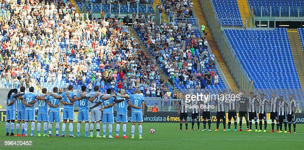 Lazio and Juventus FC players observe a minute of silence in memory of the victims of the earthquake that shook central Italy during the Serie A...