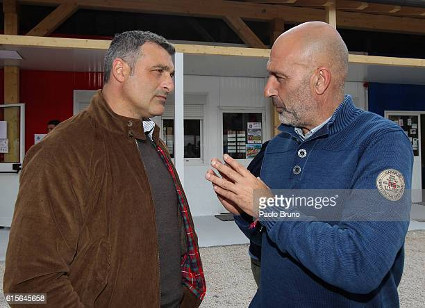 SS Lazio Club Manager Angelo Peruzzi and Amatrice Mayor Sergio Pirozzi speaks during the official team photo on October 19 2016 in Amatrice near...