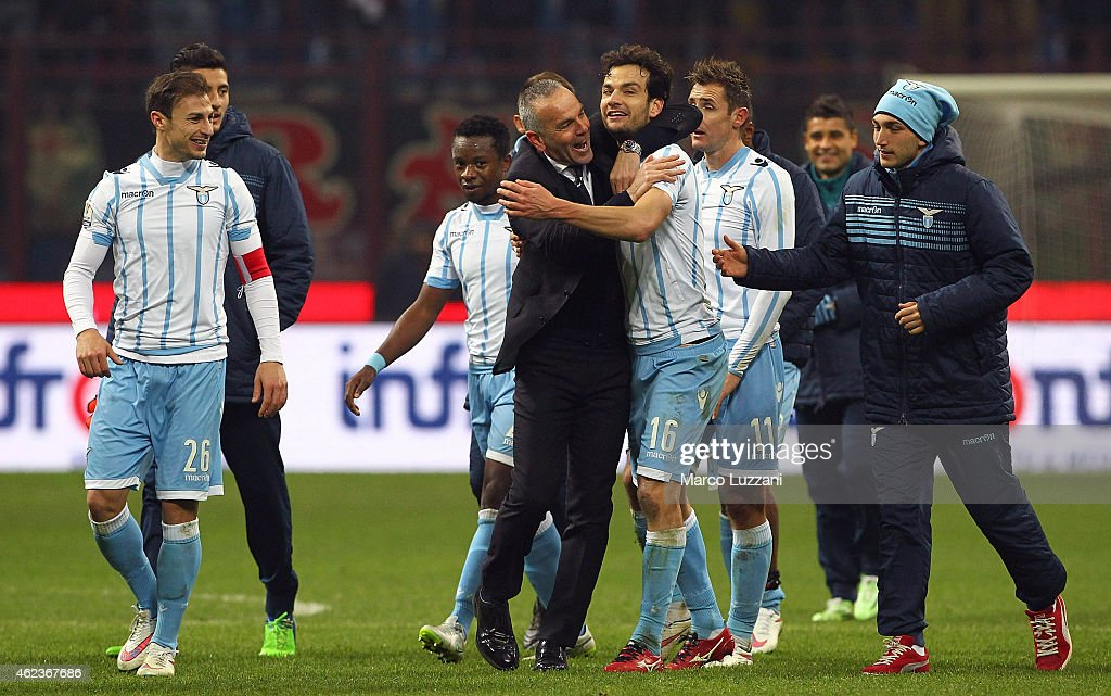 SS Lazio coach Stefano Pioli embraces Marco Parolo at the end of the TIM Cup match between AC Milan and SS Lazio at Stadio Giuseppe Meazza on January 27, 2015 in Milan, Italy.