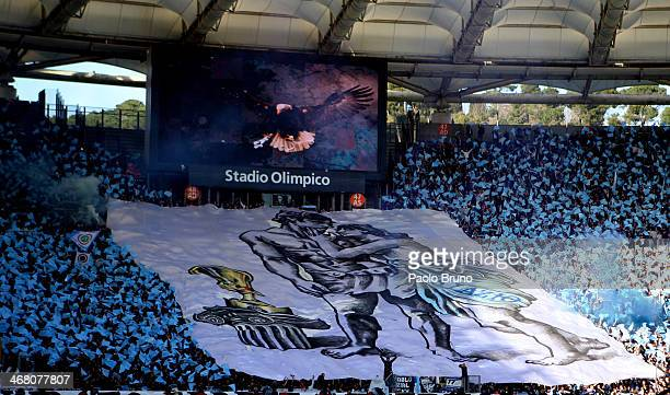 Lazio fans support their team during the Serie A match between SS Lazio and AS Roma at Stadio Olimpico on February 9 2014 in Rome Italy