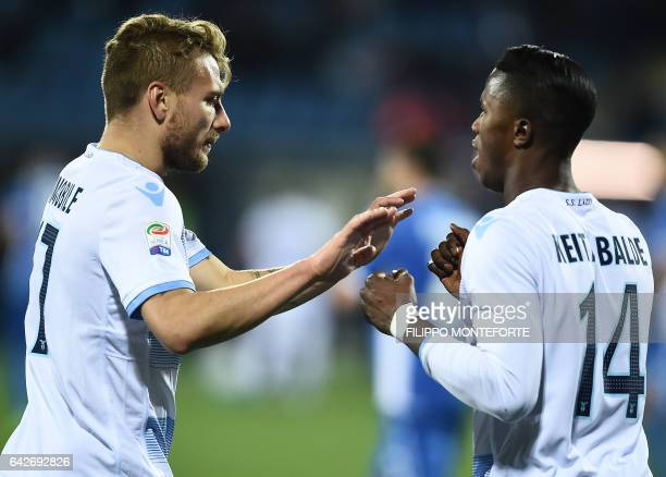 Lazio forward from Italy Ciro Immobile celebrates with Lazio's forward from Senegal Balde Diao Keita after he scored during the italian Serie A...