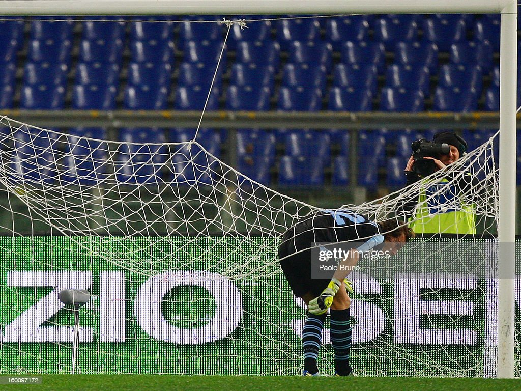 S.S. Lazio goalkeeper Fabrizio Marchetti remains entrapped in the net during the Serie A match between S.S. Lazio and AC Chievo Verona at Stadio Olimpico on January 26, 2013 in Rome, Italy.