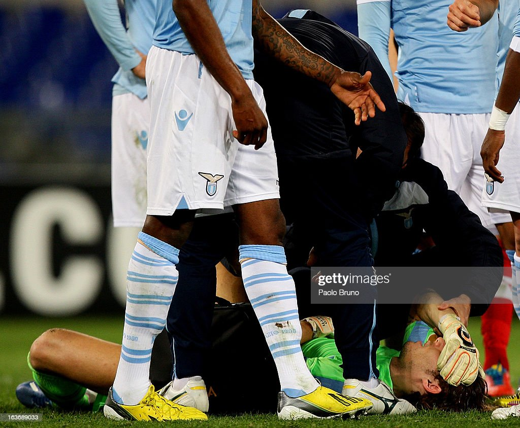 S.S. Lazio goalkeeper Federico Marchetti is injured during the UEFA Europa League Round of 16 second leg match between S.S. Lazio and VfB Stuttgart at Stadio Olimpico on March 14, 2013 in Rome, Italy.