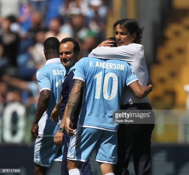 Lazio head coach Simone Inzaghi with Felipe Anderson celebrate the victory after the Serie A match between AS Roma and SS Lazio at Stadio Olimpico on...
