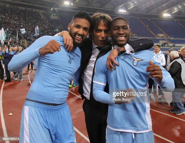 Lazio head coach Simone Inzaghi with Wallace and Bastos celebrate after the TIM Cup match between AS Roma and SS Lazio at Stadio Olimpico on April 4...