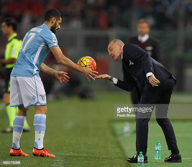 Lazio head coach Stefano Pioli gives the ball to Antonio Candreva during the Serie A match between SS Lazio and AC Milan at Stadio Olimpico on...