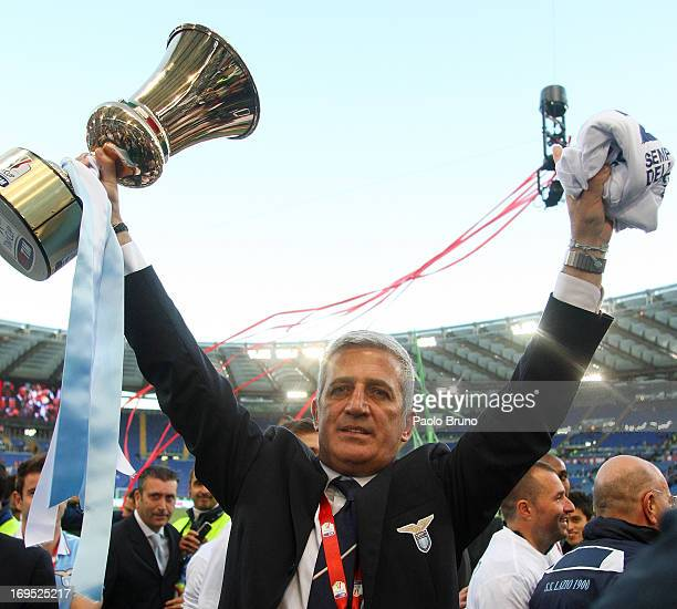 Lazio head coach Vladimir Petkovic celebrates with the trophy after winning the Tim cup final against AS Roma at Stadio Olimpico on May 26 2013 in...