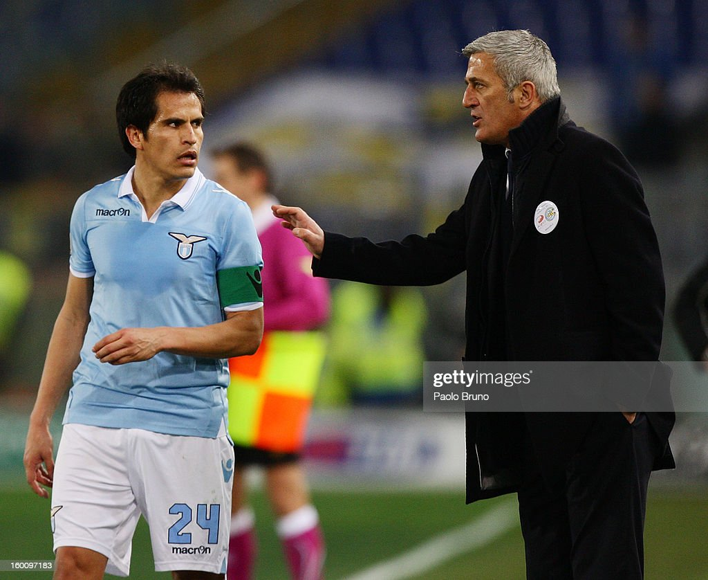 S.S. Lazio head coach Vladimir Petkovic (R) speacks with his player Cristian Ledesma during the Serie A match between S.S. Lazio and AC Chievo Verona at Stadio Olimpico on January 26, 2013 in Rome, Italy.