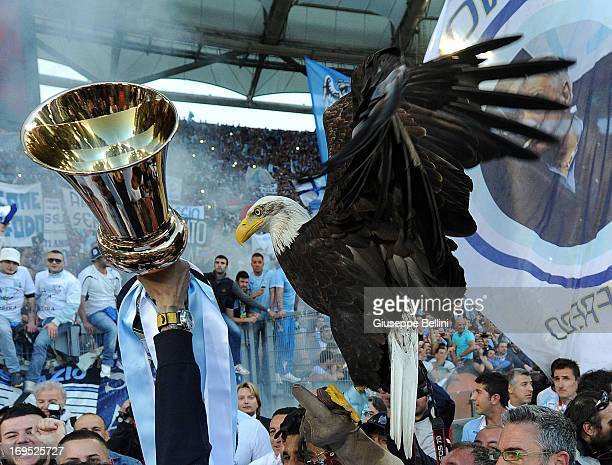 Lazio mascot Olimpia a female American golden eagle is held with Tim Cup after the TIM cup final match between AS Roma v SS Lazio at Stadio Olimpico...