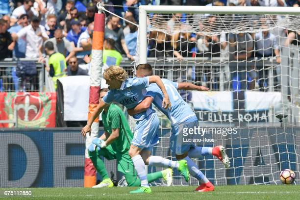 Lazio player Dusan Basta and Sergej Milinkovic Savic celebrate the goal during the Serie A match between AS Roma and SS Lazio at Stadio Olimpico on...