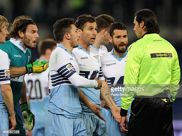 Lazio players argue with the referee Andrea Gervasoni after showing the red card to goalkeeper Federico Marchetti during the Serie A match between SS...