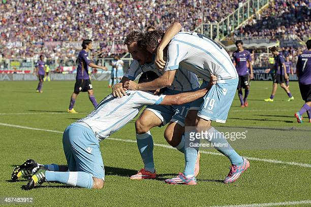 Lazio players celebrate a goal scored by Senad Lulic during the Serie A match between ACF Fiorentina and SS Lazio at Stadio Artemio Franchi on...