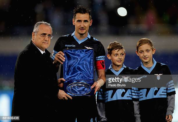 SS Lazio President Claudio Lotito and Miroslav Klose pose with the award ahead the farewell match before the Serie A match between SS Lazio and ACF...