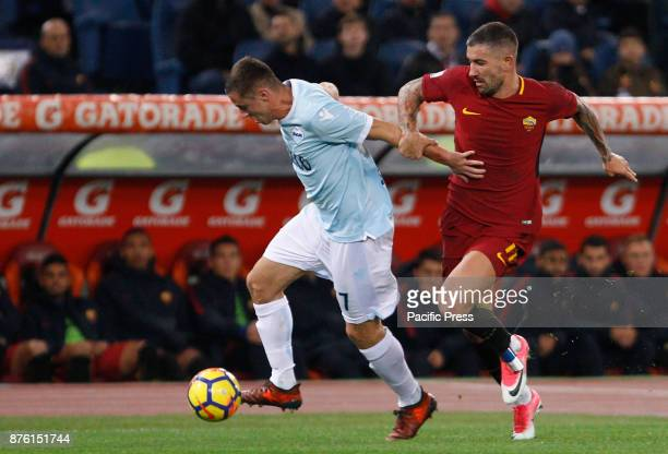 Lazio's Adam Marusic left and Roma's Aleksandar Kolarov fight for the ball during the Serie A soccer match between Roma and Lazio at the Olympic...