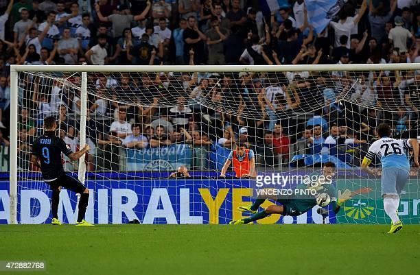Lazio's Albanian goalkeeper Etrit Berisha stops a penalty kick by Inter Milan's Argentinian forward Mauro Icardi during their Italian Serie A...