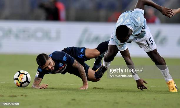 Lazio's Angolan defender Bastos Jacinto Quissanga vies with with Napoli's Italian forward Lorenzo Insigne during the Serie A football match between...
