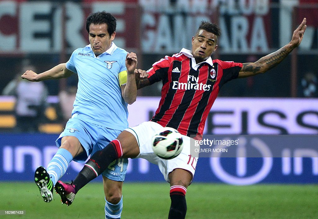 Lazio's Argentinian midfielder Cristian Ledesma (L) vies for the ball with AC Milan's Ghanaian defender Prince Kevin Boateng during the Italian Serie A match between AC Milan and Lazio on March 2, 2013 at San Siro Stadium in Milan.