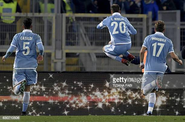 Lazio's Argentinian midfielder Lucas Biglia celebrates after scoring a goal during the Serie A football match between Lazio and Fiorentina at Olympic...