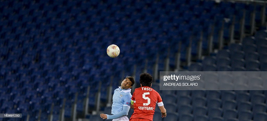 Lazio's Brazilian forward Ederson Honorato Campos (L) jumps for the ball against Stuttgart's defender Serdar Tasci during the UEFA Europa League football match Lazio versus Stuttgart at Rome's Olympic stadium, on March 14, 2013.