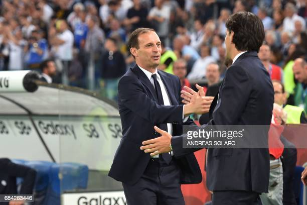 Lazio's coach from Italy Simone Inzaghi greets Juventus' coach from Italy Massimiliano Allegri before the Italian Tim Cup final on May 17 2017 at the...