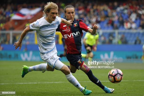 Lazio's defender Dusan Basta of Serbia fights for the ball with Genoa's midfielder Diego Laxalt from Uruguay during the Italian Serie A football...