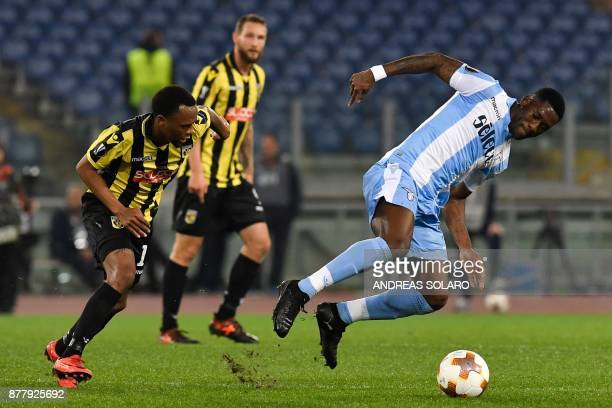 Lazio's defender from Angola Bastos fights for the ball with Vitesse Arnhem's midfielder from South Africa Thulani Serero during the UEFA Europa...