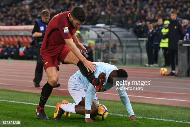 Lazio's defender from Angola BastosBartolomeu Jacinto Quissanga fights for the ball with Roma's Dutch midfielder Kevin Strootman during the Italian...
