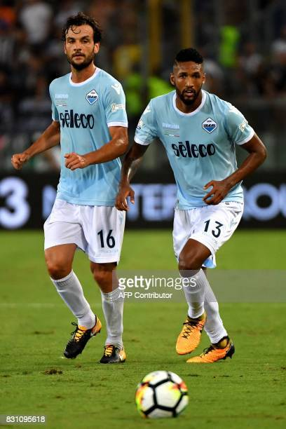 Lazio's defender from Brazil Wallace Fortuna dos Santos and Lazio's midfielder Marco Parolo eyes the ball during the Italian SuperCup TIM football...