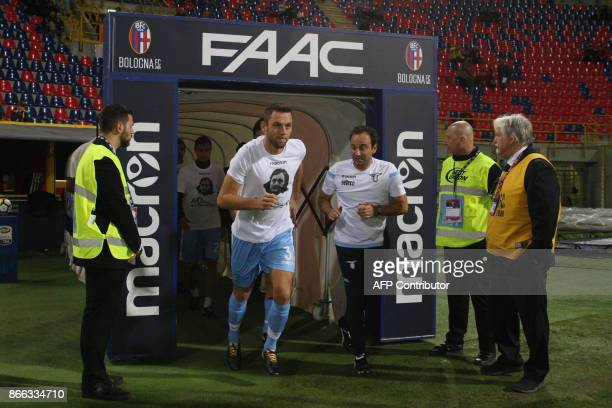 Lazio's defender from Netherlands Stefan de Vrij wears a tshirt showing an image of holocaust victim Anne Frank during the warm up prior the Italian...