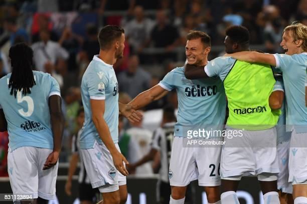 Lazio's defender from Romania Stefan Radu celebrates with teammates after winning the Italian SuperCup TIM football match Juventus vs lazio on August...