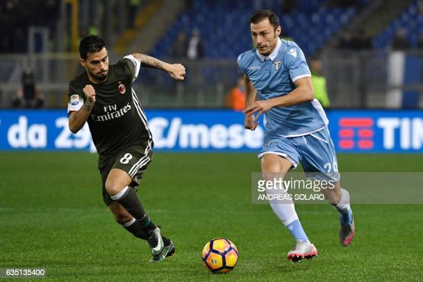 Lazio's defender from Romania Stefan Radu vies for the ball with AC Milan's forward from Spain Fernandez Suso during the Italian Serie A football...