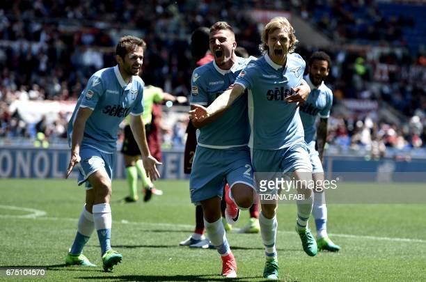 Lazio's defender from Serbia Dusan Basta celebrates with teammates Lazio's midfielder from Serbia Sergej MilinkovicSavic after scoring during the...