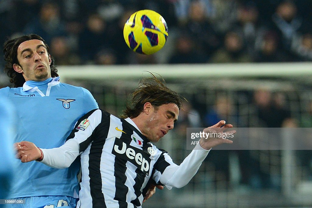 Lazio's defender Giuseppe Biava (L) vies with Juventus' forward Alessandro Matri during their TIM CUP football match between Juventus and Lazio at the 'Juventus Stadium' in Turin on January 22, 2013. AFP PHOTO / GIUSEPPE CACACE