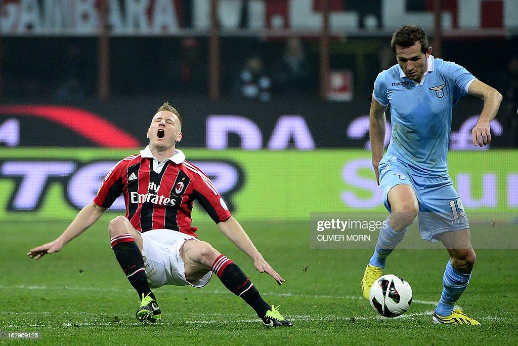 Lazio's defender of Bosnia and Herzegovina Senad Lilic (R) controls the ball near AC Milan's midfielder Ignazio Abate during the Italian Serie A match between AC Milan and Lazio on March 2, 2013 at San Siro Stadium in Milan.