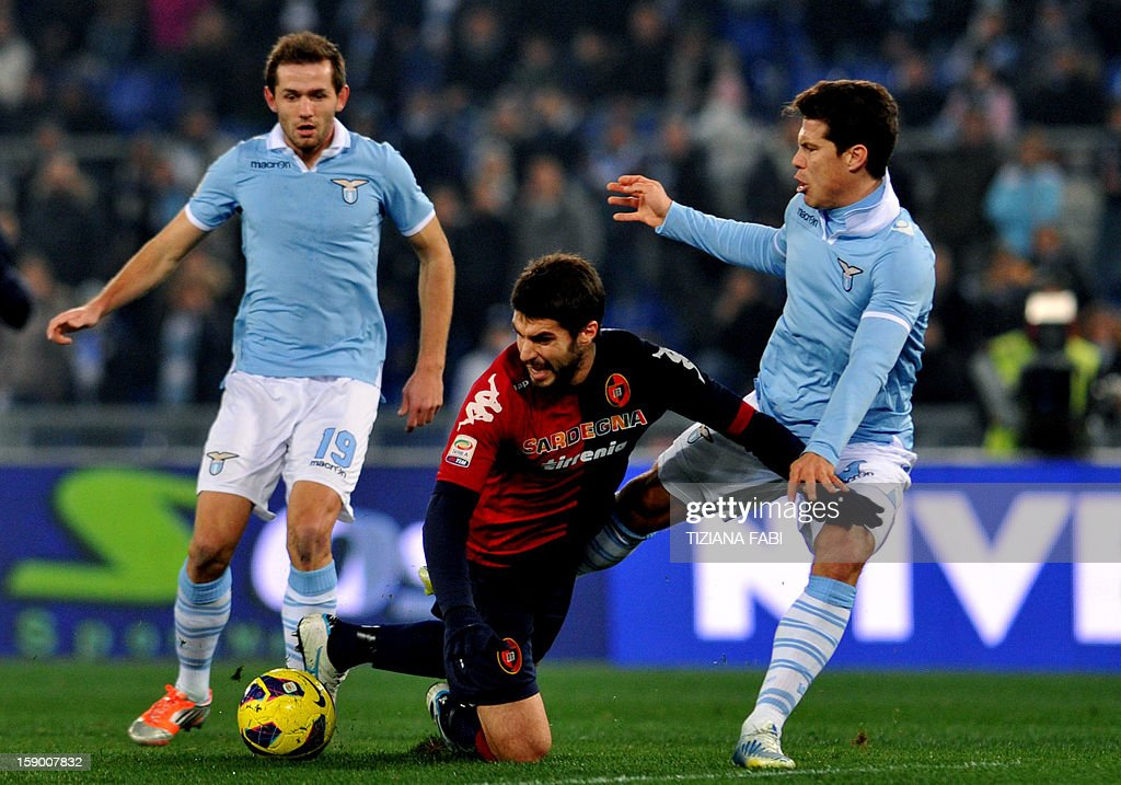 Lazio's defender of Bosnia and Herzegovina Senad Lilic (L) vies with Lazio's Brazilian midfielder Anderson Hernanes (R) and Cagliari's defender Luca Rossettini during their Serie A football match at the Olympic stadium on January 5, 2013 in Rome.