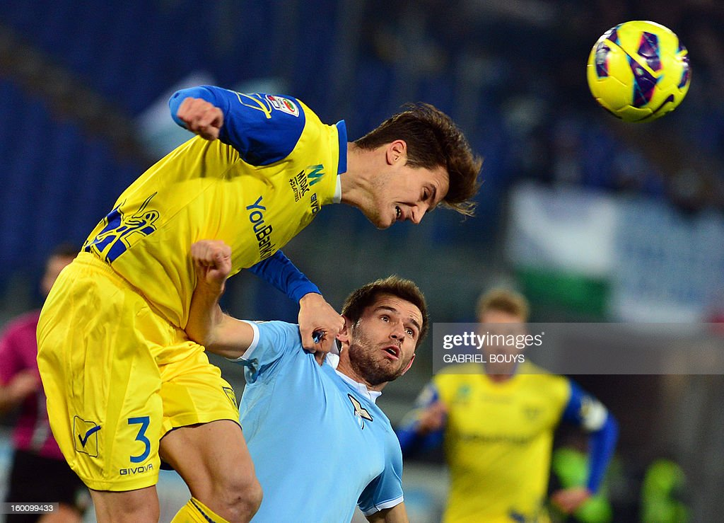 Lazio's defender of Bosnia and Herzegovina Senad Lulic (R) fights for the ball with Chievo midfielder Marco Andreolli during the Italian Serie A football match between Lazio Rome and Chievo Verona on January 26, 2013, at the Olympic stadium in Rome.