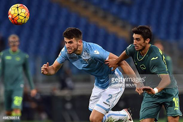 Lazio's defender Wesley Hoedt from Netherlands vies with Palermo's midfielder Gaston Brugman from Uruguay during the Italian Serie A football match...