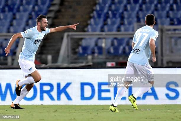 Lazio's Dutch defender Stefan de Vrij celebrates after scoring during the Serie A football match between Lazio and Napoli at Olympic Stadium in Rome...