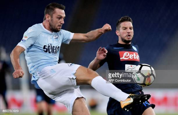 Lazio's Dutch defender Stefan de Vrij fights for the ball with Napoli's Belgian striker Dries Mertens during the Serie A football match between Lazio...