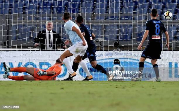 Lazio's Dutch defender Stefan de Vrij scores a goal during the Italian Serie A football match between Lazio and Napoli at Olympic Stadium in Rome on...