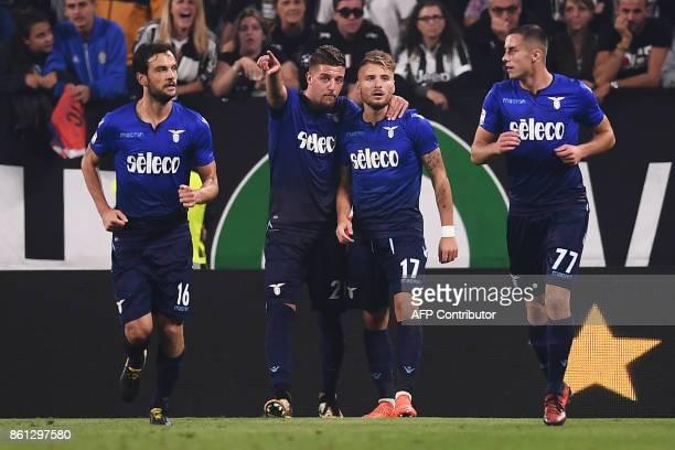 Lazio's forward Ciro Immobile celebrates after scoring with teammate Lazio's midfielder Sergej MilinkovicSavic from Serbia during the Italian Serie A...