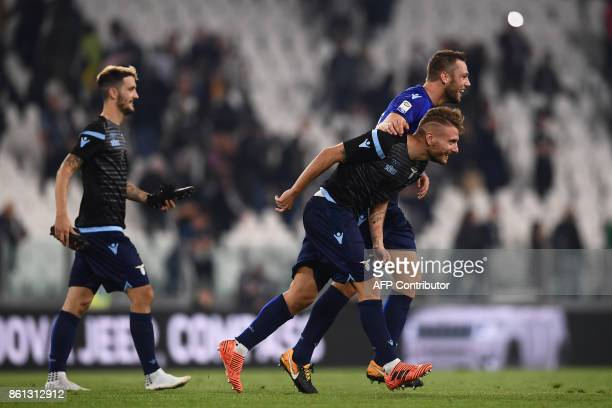 Lazio's forward Ciro Immobile celebrates with teammates at the end of the Italian Serie A football match Juventus Vs Lazio on October 14 2017 at the...